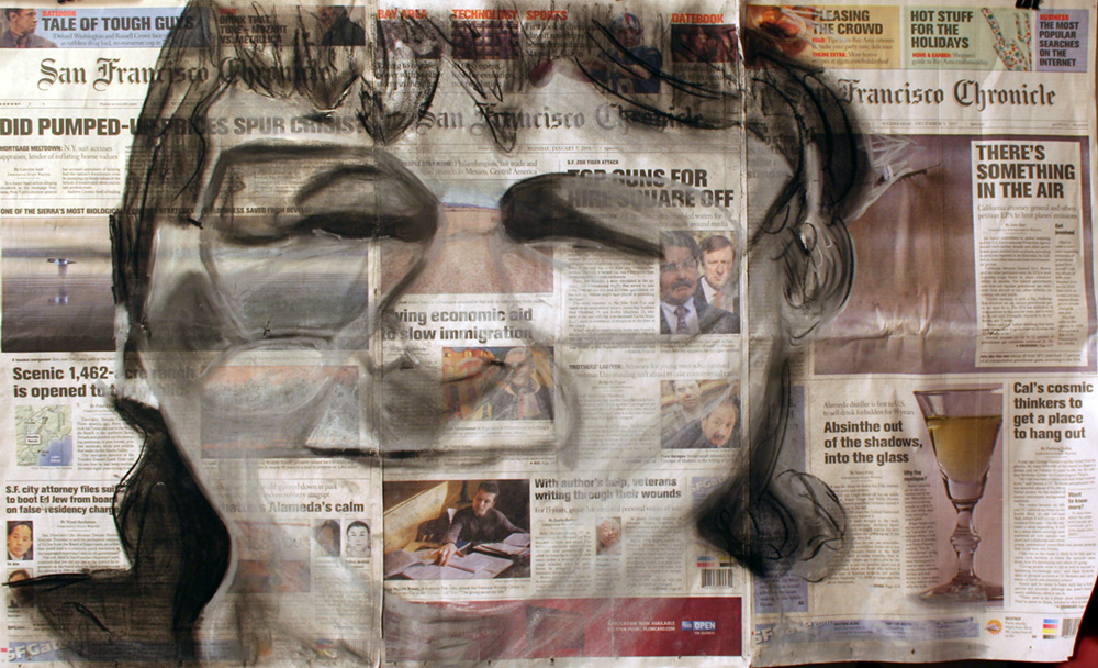 a woman's portrait is drawn with charcoal on a newspaper
