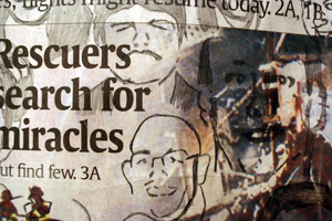 detail of a newspaper with portraits drawn on it