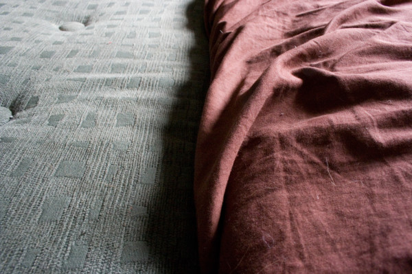 cushion and bed sheets side by side