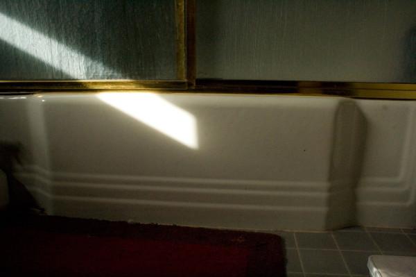 light shining onto a bathroom shower tub