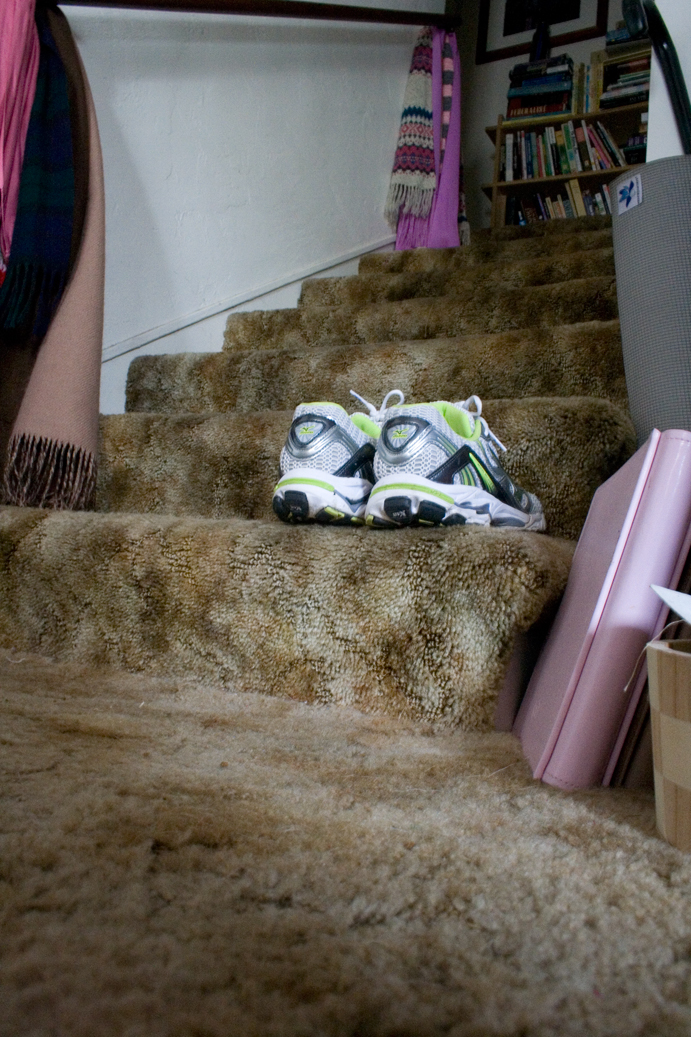running shoes sitting on the stairs