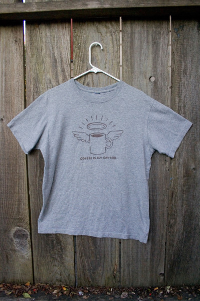 tshirt with an picture of a coffee mug with angel wings and a halo