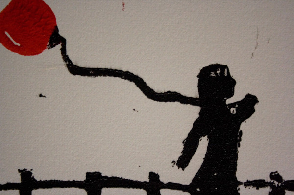 close up of a print of  a girl with a red balloon