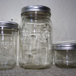 three different sized ball jars on a table top