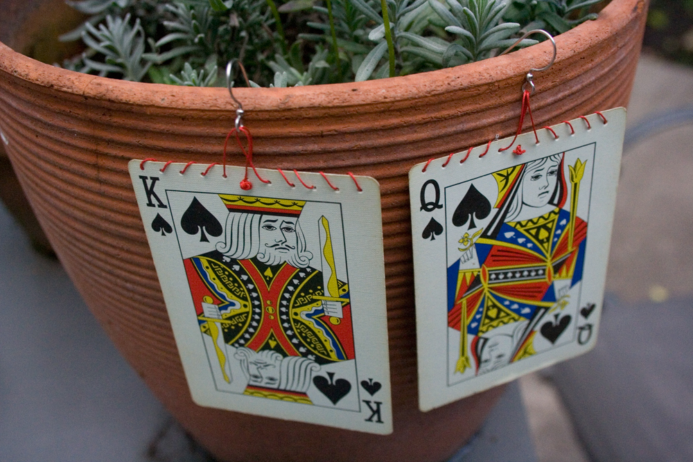 earrings made from playing cards hanging on a planter