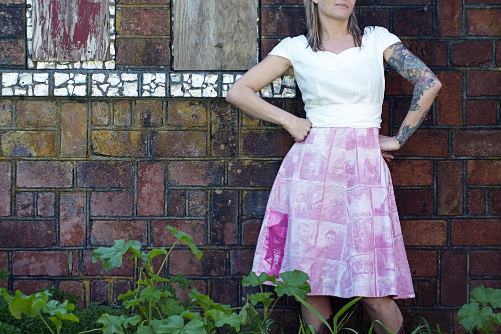portrait of a woman wearing a skirt that has photographs transferred on to it