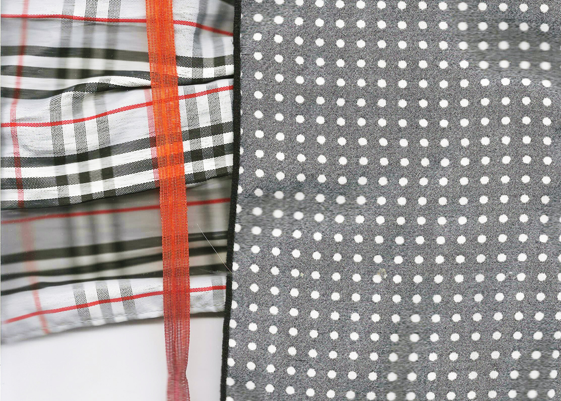 a composition of patterns - plaid and polka dots mostly in black and white