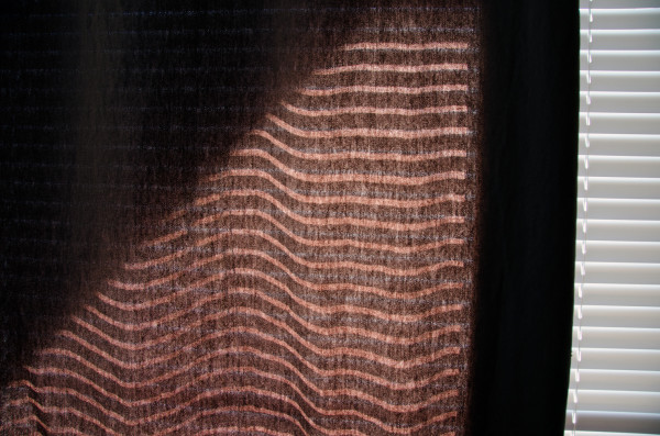 sun shining through a curtain