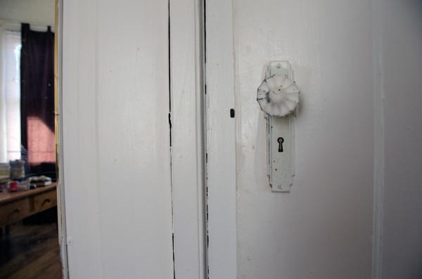 a door knob and a mirror