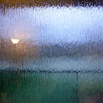 abstract photograph of a textured window with light on both sides
