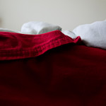 scrunched up red bed sheets